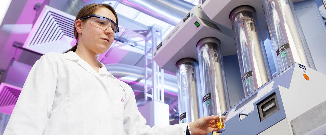 Scientist holding sample for measurement